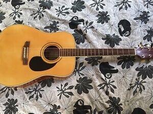 Acoustic guitar. SX.