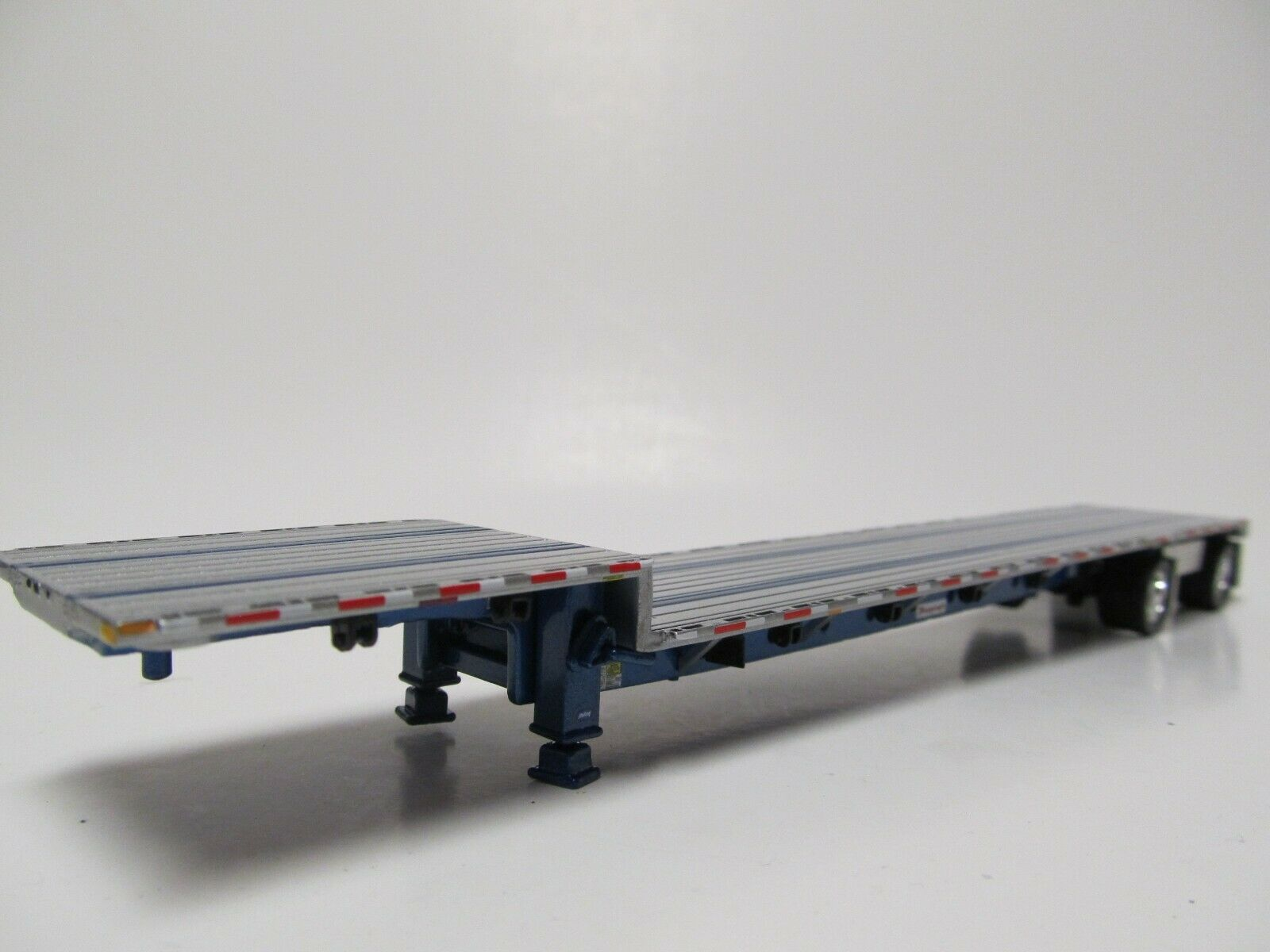 DCP 1/64 SCALE TRANSCRAFT STEP DECK TRAILER SILVER DECK WITH BLUE FRAME