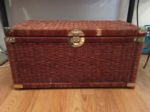 Large wicker chest with gold trim