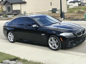 2011 BMW  550i X-Drive M-pack with factory warranty