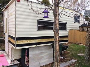 Truck camper with utility trailer under