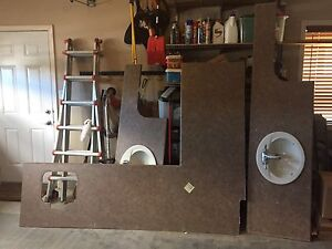 Various Countertops With Sinks And Faucets