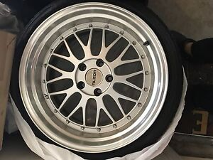 """Selling 18"""" rim and summer tires. Great look. 5*112"""