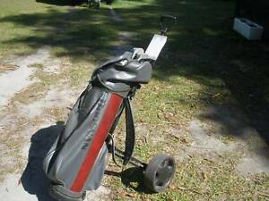 Brosnan golf clubs and cart