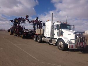 Farm equipment hauling and towing ( Landoll RGN)