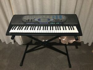 Casio CTK-571 Electronic Piano Keyboard with Adjustable Stand