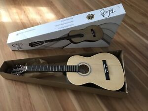 New acoustic aguitar in box