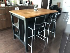 Wood island with extra storage. Includes 4 chairs