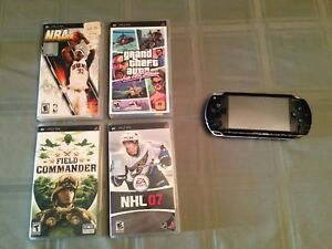 PSP with 4 games, charger and 2GB memory card
