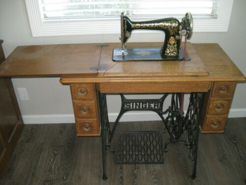 Antique Singer Sewing Machine MODEL 66 with 7- Drawer Oak Cabinet