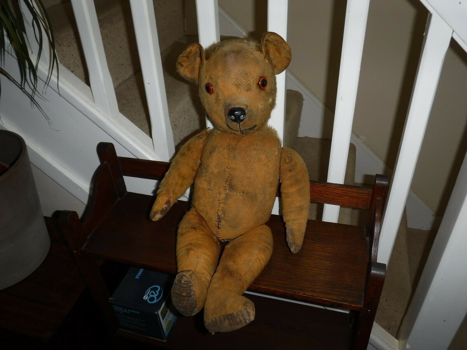 ANTIQUE OLD TEDDY IN NEED OF TLC. APPROX 20 INCHES TALL. HUMP BACK