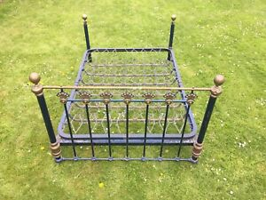 Antique brass & blue double bedstead, original sprung base with bed knobs.
