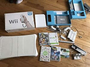 Wii + wii fit + 3 remotes + remote charger + games