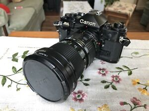 Canon A-1    35mm Camera + 2 Canon FD Zoom lens (MINT)