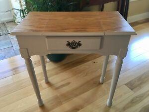 Small jewelry table with seat