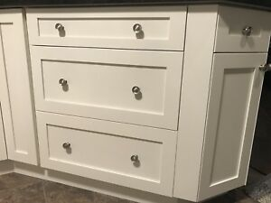 Cabinet drawers with self closing hardware