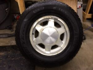 G M C truck tires and 16 inch rims .