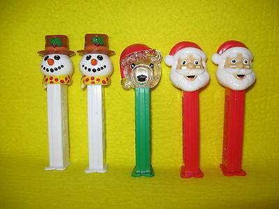 5 Pez Candy Dispensers 2 Snowmen 1 Transparent Teddy Bear 2 Santa Claus China