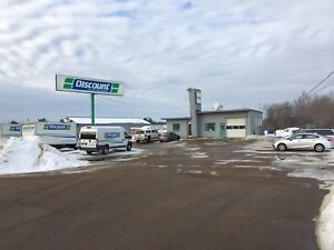 Commercial Lot with building and Gated back.