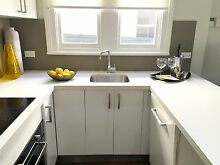 U Shaped All-White Kitchen with Appliances and Stone Benchtop Lewisham Marrickville Area Preview