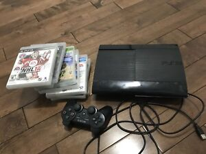 PS3 console with 8 games and one controller
