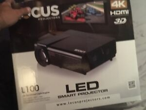 Projector and home theatre system with screen