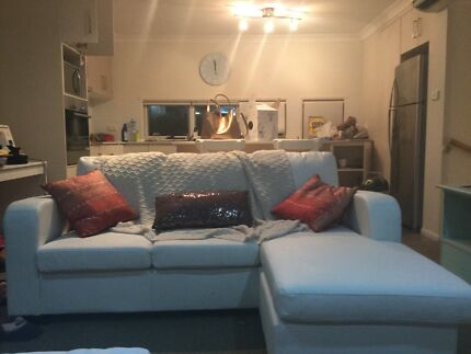 white leather lounge with chase Manly Brisbane South East Preview