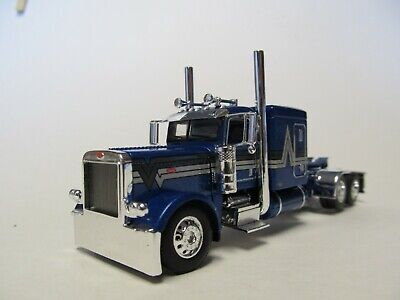 DCP FIRST GEAR 1/64 SCALE 389 PETERBILT FLAT TOP, BLUE WITH BLACK/ SILVER STRIPE