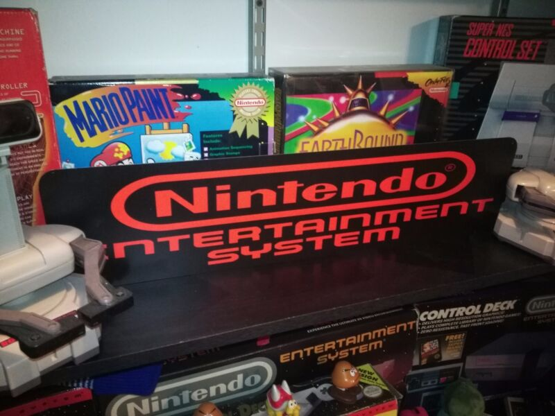 "NES Display, Nintendo Entertainment System, Aluminum Sign, 6"" x 24""."