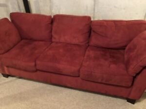 Red couch and loveseat