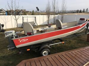 14 ft Lund fishing boat with 15hp Johnson
