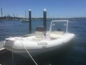 NEAR NEW RIGID INFLATABLE BOAT WITH TRAILER