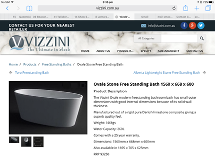 Vizzini stone free standing bath