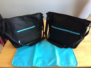 Two brand new diaper bags with change pad