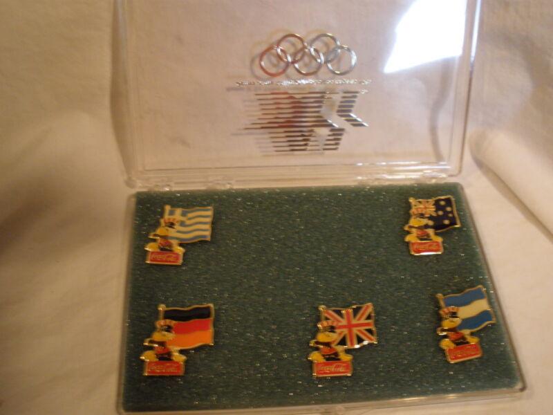 VTG RARE COCA-COLA 1984 L. A. OLYMPICS SET OF 5 TAC PIN IN A CASE (GREECE, ETC.)
