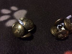 Military brass jacket buttons