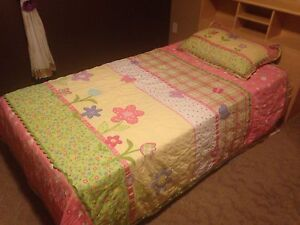 Girls single bedding, curtains, and wall hangings