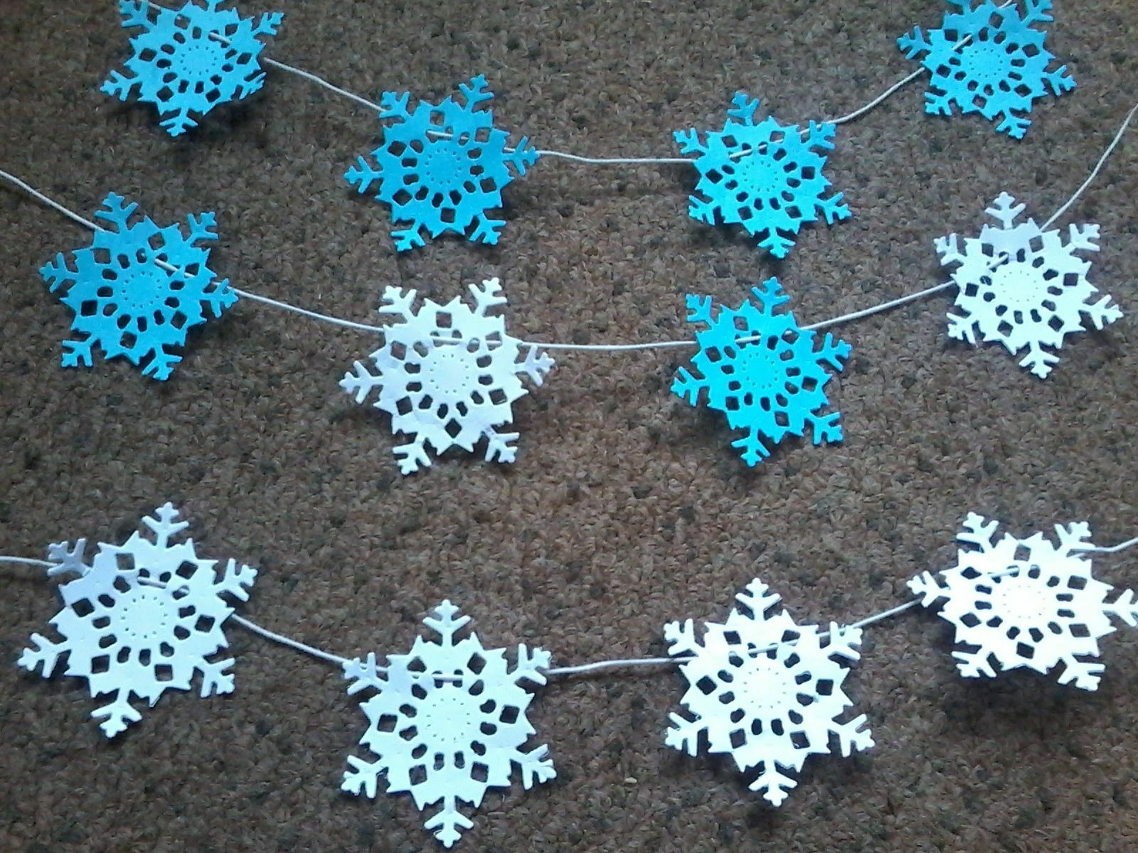 make a paper snowflake It's really easy to make your own diy paper snowflake garland for an easy, fun christmas decoration all you need is paper, scissors and some string.