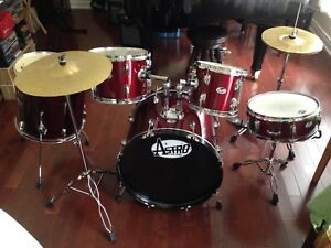 Full drum set, as pictured, including stands, throne and sticks