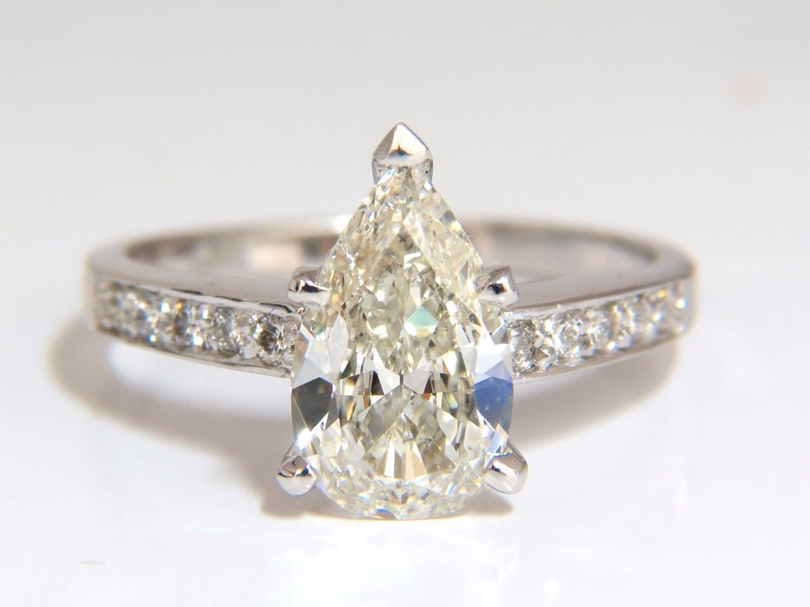 GIA Certified 1.49ct Pear Shape diamond ring .20ct. round accents 14kt 2