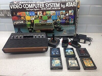 Atari 2600 Console - AV modified - With games, paddles + joystick controller