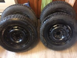 4 New Goodyear Nordic tires with rims