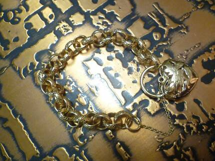 GOLD PLATED LIFE TIME GUARANTEE BRACELET EXCELLENT CONDITION.