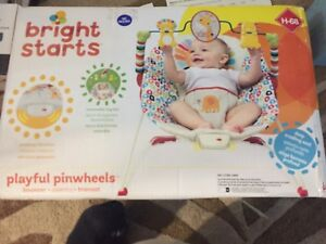 Brand new baby bouncer seat with vibration and toys