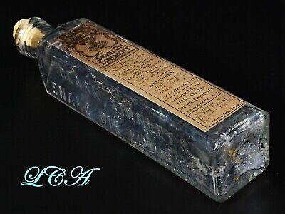 ORIGINAL antique SNAKE OIL HORSE MEDICINE embossed bottle w/LABEL Clark Stanley