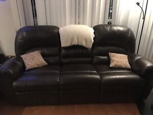 Brown leather couch with folding tray table