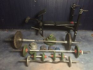 Bench press and assortment of cast weights