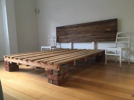 Unique Pallet Bed with Wood Headboard and Brick Base
