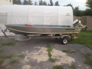 Aluminum boat and motor and trailer