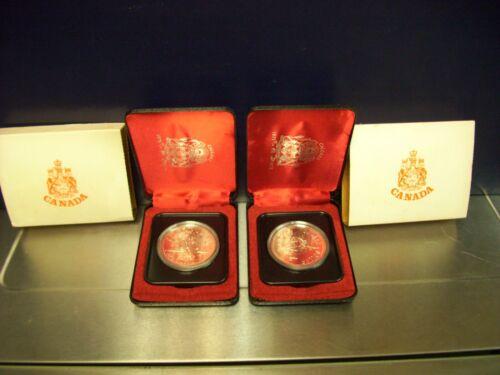 1975 CALGARY 1875-1975 COMMEMORATIVE DALLAR COIN  (2) PROOF-LIKE NICE